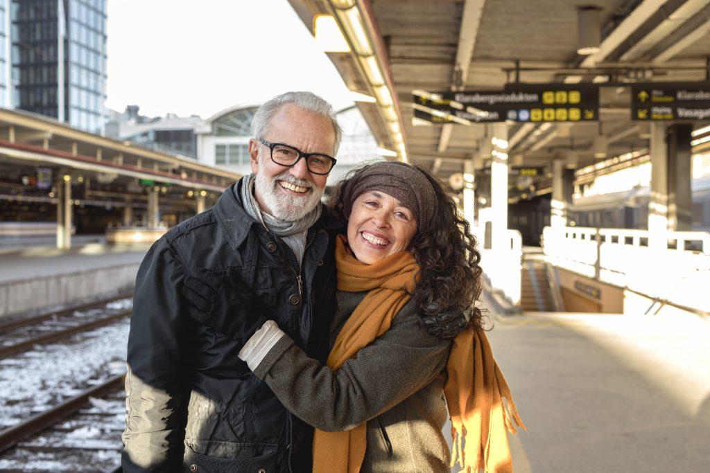 Frende Forsikring - Mann og dame som smiler